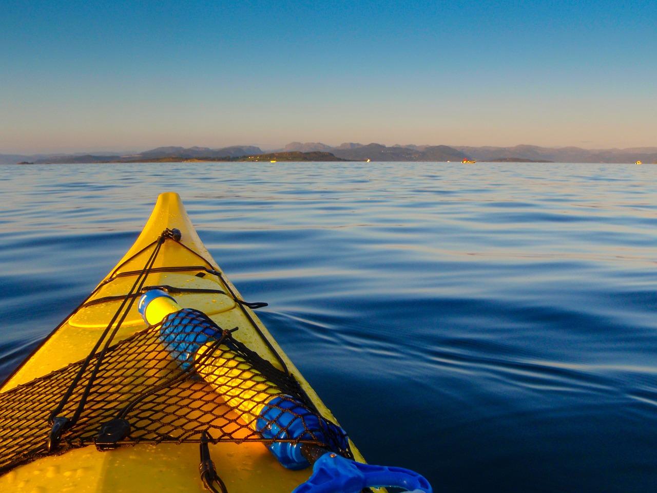 yellow kayak and sea